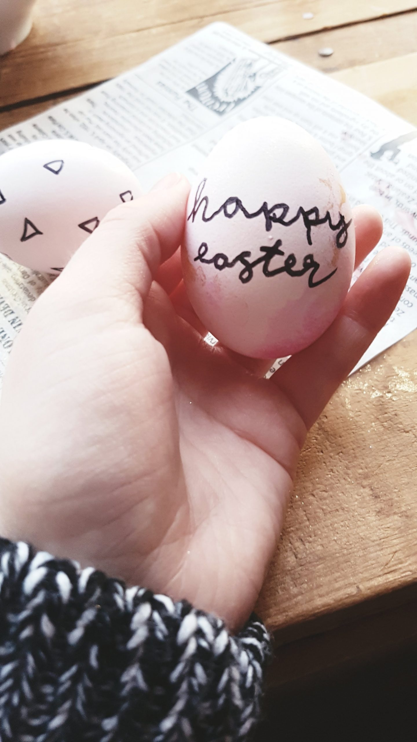 person holding Easter egg